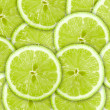 Abstract green background with citrus-fruit of lime slices — Stock Photo #6350847