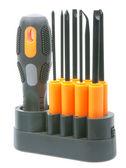 Set of orange-black screwdrivers with bits — Stock Photo