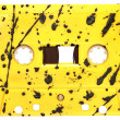 Vintage yellow audio cassette. - Stock Photo