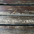 Weathered and scratched wooden plank - Foto Stock