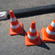 Three orange cone sign - Foto Stock