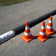 Stock Photo: Three orange cone sign