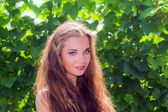 Portrait beautiful girl on nature — Stock Photo
