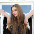 Beautiful girl in window — Stock Photo #6674141