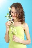 Girl holding flower cherry — Stock Photo