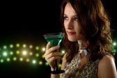Young woman with a green cocktail — Stock Photo
