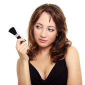 An attractive young lady with makeup brush — Stock Photo