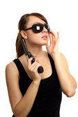 Young woman with gun — Stock Photo