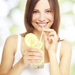 Girl holding a lemonade — Stock Photo