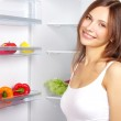 Picking food from fridge — Stock Photo #6000486