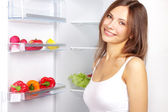 Picking food from fridge — Stock Photo