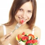 Teenage Girl Eating Fresh Salad — Stock Photo #6018509