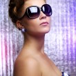 Young woman wearing sunglasses — Stock Photo #6080676