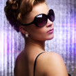 Stock Photo: Young womwearing sunglasses