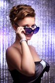 Sexy young woman wearing sunglasses. — Stock Photo