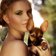 Portrait of a beautiful girl with Miniature Pinscher — Stock Photo #6442566