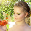 Girl with ashberries - Stock Photo