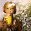 Stock Photo: Young womwith glass of orange juice