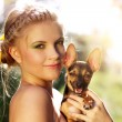 Portrait of a beautiful girl with Miniature Pinscher — Stock Photo