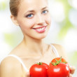 Girl with three red tomatoes — Stock Photo #6706747