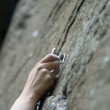 Climbers hand and quick-draws — Stock Photo