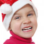 Cute little smiling Santa girl — Stock Photo