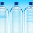 Misted plastic bottles with fresh clear water - Stock Photo