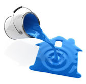 Blue paint pouring from bucket in house silhouette — Stock Photo