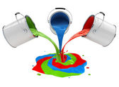 Color paint pouring from buckets and mixing — Stock Photo