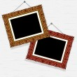 Empty pictures in decorative frame on ñòåí — Stock Vector