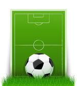 Piłka na zielone pole z trawy — Wektor stockowy