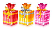 Set of packaged holiday gifts with bow — Stockvector