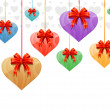 Hanging hearts with red ribbons — Stock Vector #5793643
