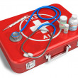Stethoscope, thermometer and drugs on red first aid case — ストック写真