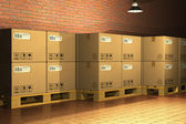 Cardboard boxes on shipping pallets — Stock Photo