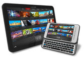 Tablet PC and side slider touchscreen smartphone — Stock Photo