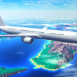 Scenic airliner flight over the ocean with resort islands - Stock Photo