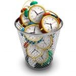 Wasting time concept: alarm clocks in the trash bin — Stock Photo