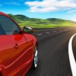 Red car driving by autobahn — Stock Photo #5586294