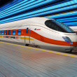Modern high speed train departs from railway station - Stock Photo