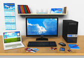 Office workplace with desktop computer, laptop and other devices — Stock Photo