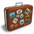 Leather travel suitcase with labels - Stock Photo