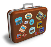Leather travel suitcase with labels — Stock Photo