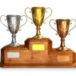 Gold, silver and bronze trophy cups on pedestal — Stock Photo #5817945