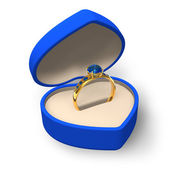Blue heart-shape box with golden ring with jewels — Stock Photo