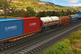 Freight train passing by mountain range — Stock Photo