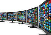 Row of widescreen HD displays wtih multiple images — Stock Photo
