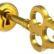 Golden key in keyhole - Stock Photo