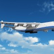 Big freight airiner in the bue sky with clouds — Stock Photo #6636795