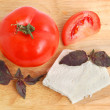 Cheese, tomato and basil — Stock Photo